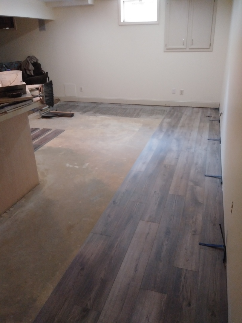 Hudsonville, MI - Got a good start on the vinyl plank floor. Hope to be finished with it tomorrow.