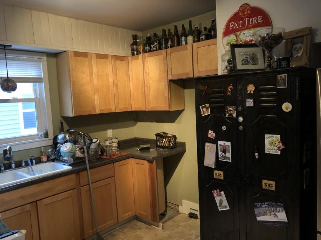Grand Rapids, MI - Water damage to kitchen, needs new cabinets, backsplash and countertops.