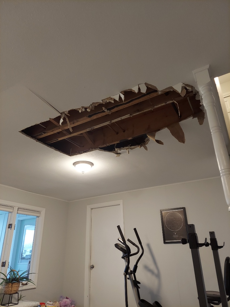 Georgetown Township, MI - Preparing to patch a finished basement ceiling. The damage was caused by a broken ice maker line.