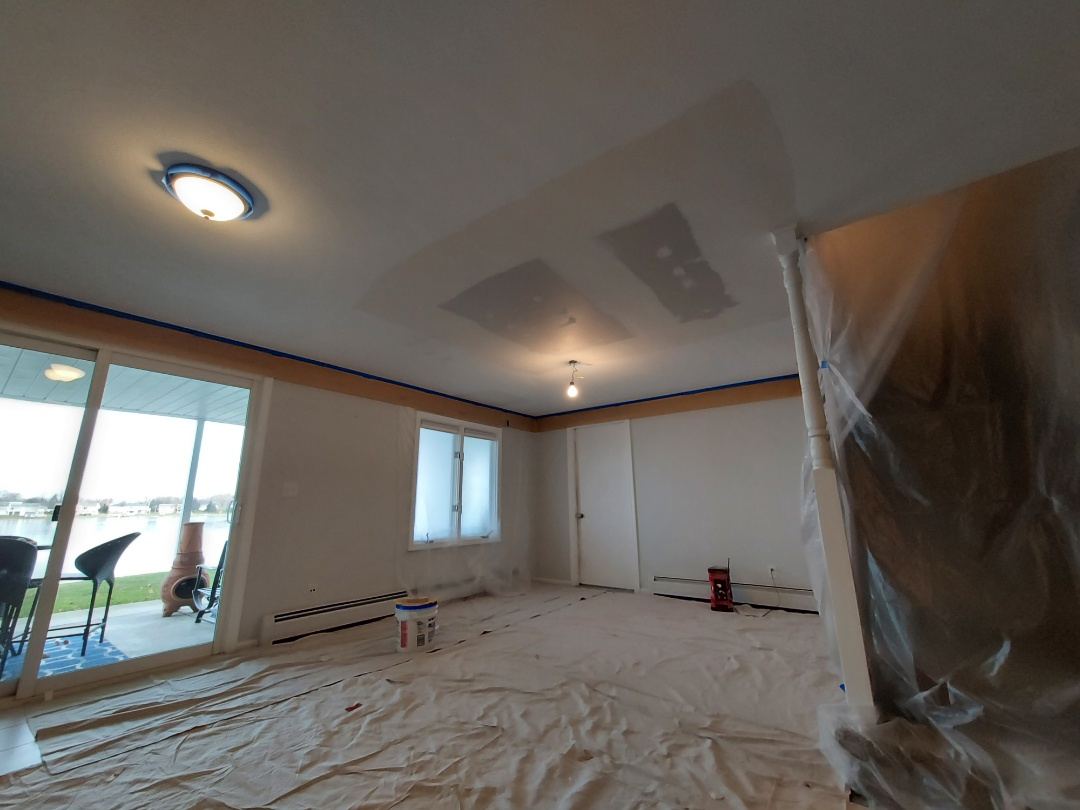 Georgetown Township, MI - Preparing to sand and texture the ceiling.   I hung plastic to contain the little bit of dust ill cause. I also hung paper around the ceiling perimeter to keep the texture material off the walls.