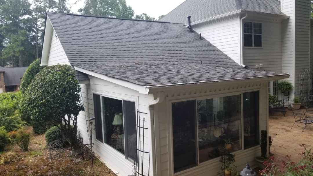 Acworth, GA - As a residential roofing contractor, Infinity Roofing  Contractors handles many tasks; including flat roofs. Make sure you do your research before hiring your next contractor! I low-slope roof like this should never be shingled only. There should be a membrane roof over this portion! GAF Liberty base and cap will do an excellent job in fixing this homeowners' problem.