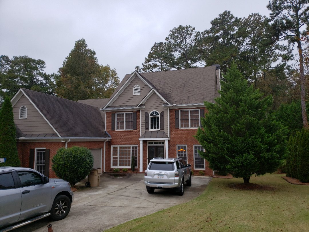 Acworth, GA - Today the weather is a little gray but we were able to brighten things up for our latest client in Kennesaw. He just bought a house in John's creek but his roof here was storm damaged. Met with his adjuster and now infinity roofing contractors will be putting on a GAF roof system, and the only cost to our client is his deductible.