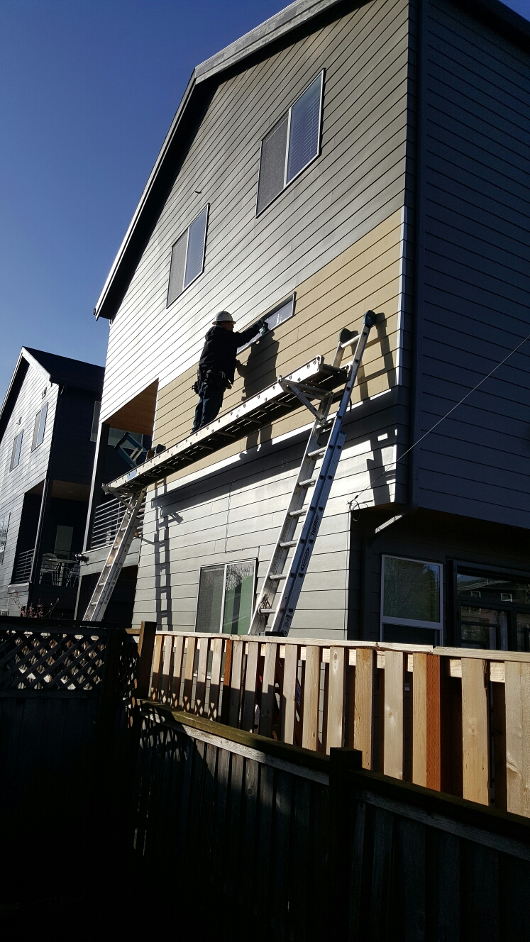 Portland, OR - New smooth James hardieplank siding. Also replaced and flashed new vinyl window.
