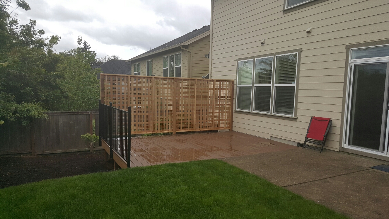 Portland, OR - Composite decking with Catalina lattice and metal railing. We framed and installed a timbertech capped deck with Catalina lattice and a fortress metal railing.