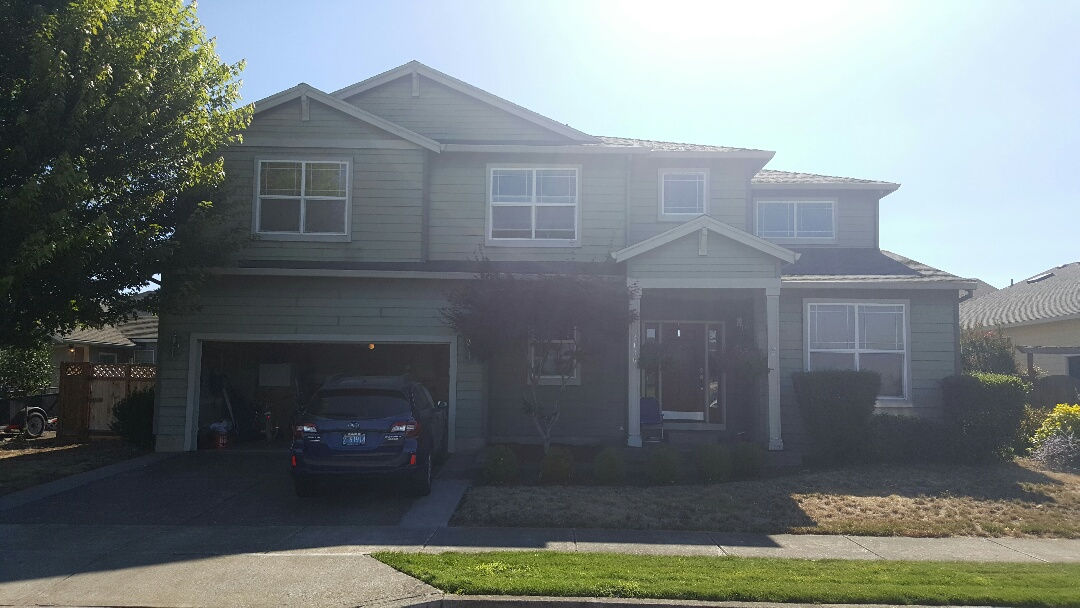 Canby, OR - CertainTeed replacement with hardieplank. This is a house with faulty CertainTeed lap siding that is cracking, swelling and shrinking. We are replacing it with Hardie plank lap siding.