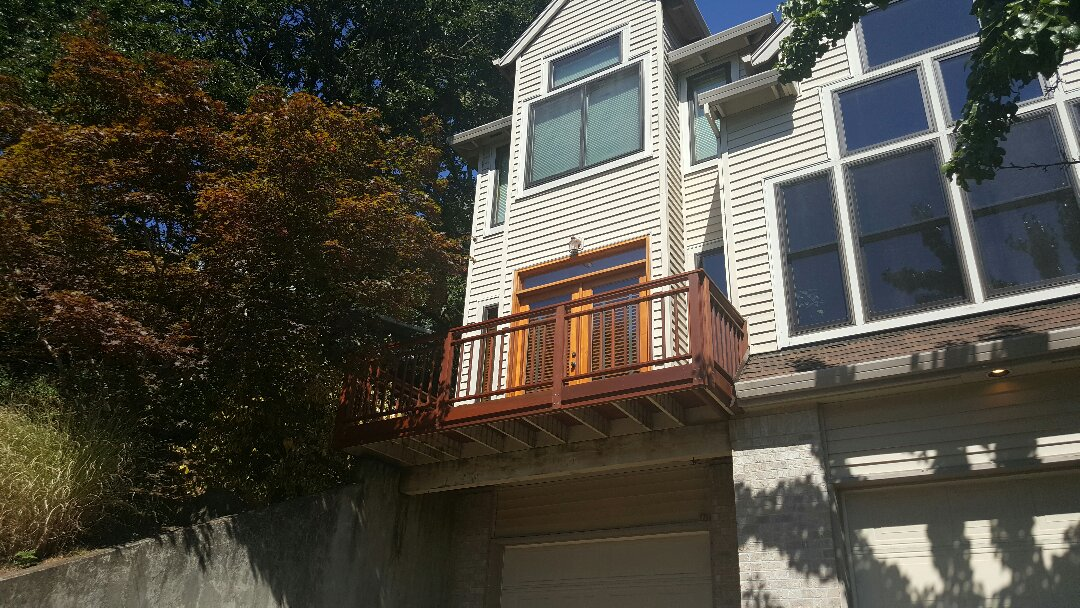 West Linn, OR - Custom stained mahogany deck with matching stained mahogany railing and pickets.