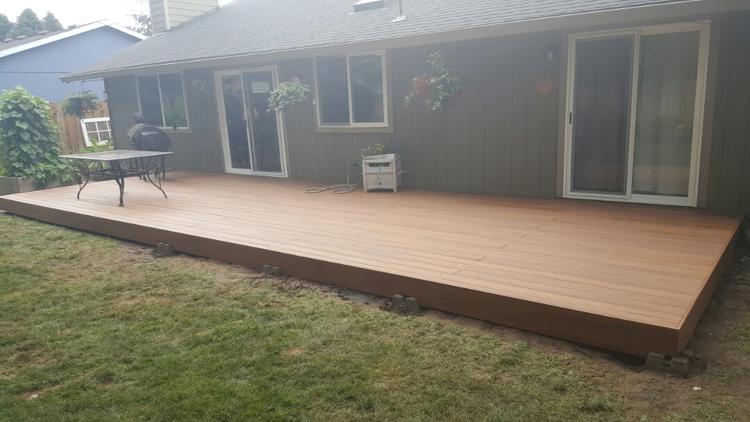 Tualatin, OR - Framed in and decked trex composite deck. We installed a new trex transcends deck color tiki torch.