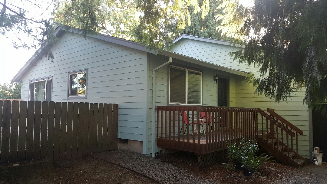 Tualatin, OR - Installed hardieplank siding over existing T1-11 siding. Removed dry rot on T1-11 siding and installed new primed James Hardie lap siding and trim. Painted with Sherwin Williams superpaint.