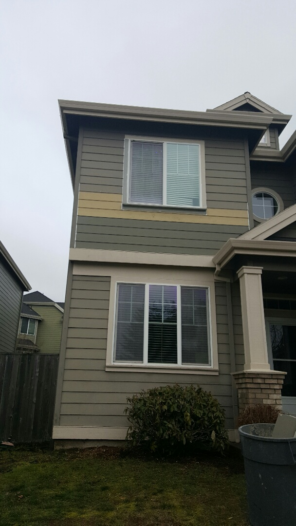 Sherwood, OR - Siding replacement. Trim repair. We repaired a leaking window with new building paper, cedar trim and James Hardie lap siding.