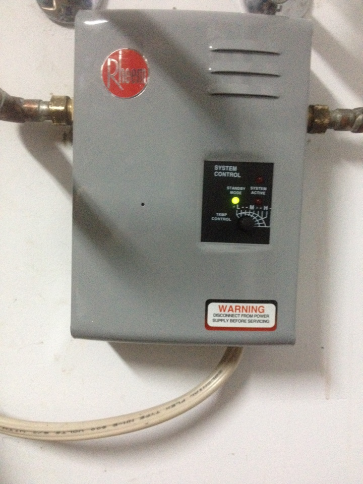Palm City, FL - Replaced a Rheem RTE-13 tankless water heater.