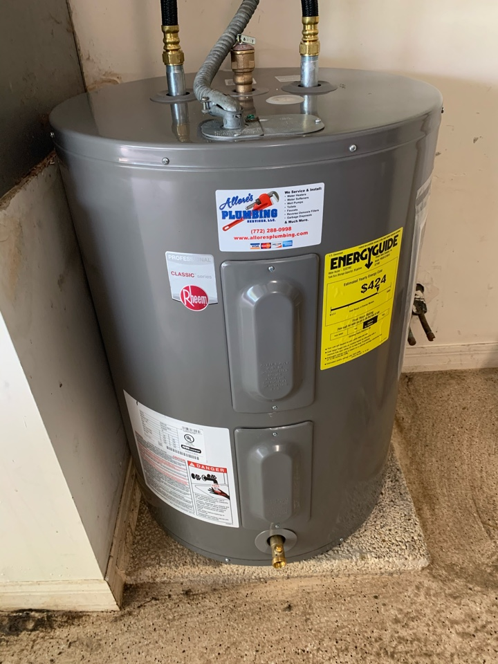 Stuart, FL - Installed a new Rheem 49 gallon short profile water heater with a new valve and flexible union connections.