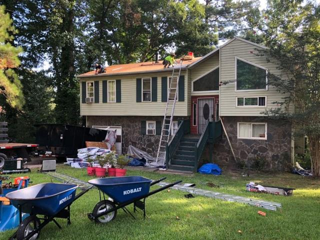 Fairburn, GA - On this fine Thursday our guys are working hard to get the job done right! Here we are repairing this families roof that was struck by a tree and replacing the siding with the best quality materials!