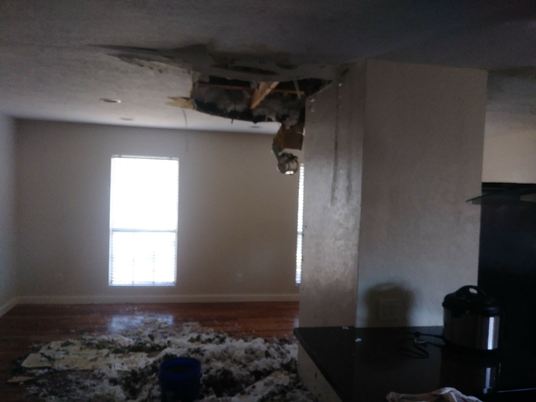 Plano, TX - We responded to a frozen pipe in the attic causing significant drywall and woodfloor damage.
