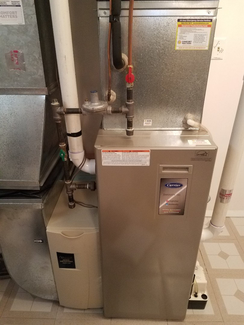 Hanover, MN - Furnace maintenance. Performed tune up and cleaning on a Carrier furnace