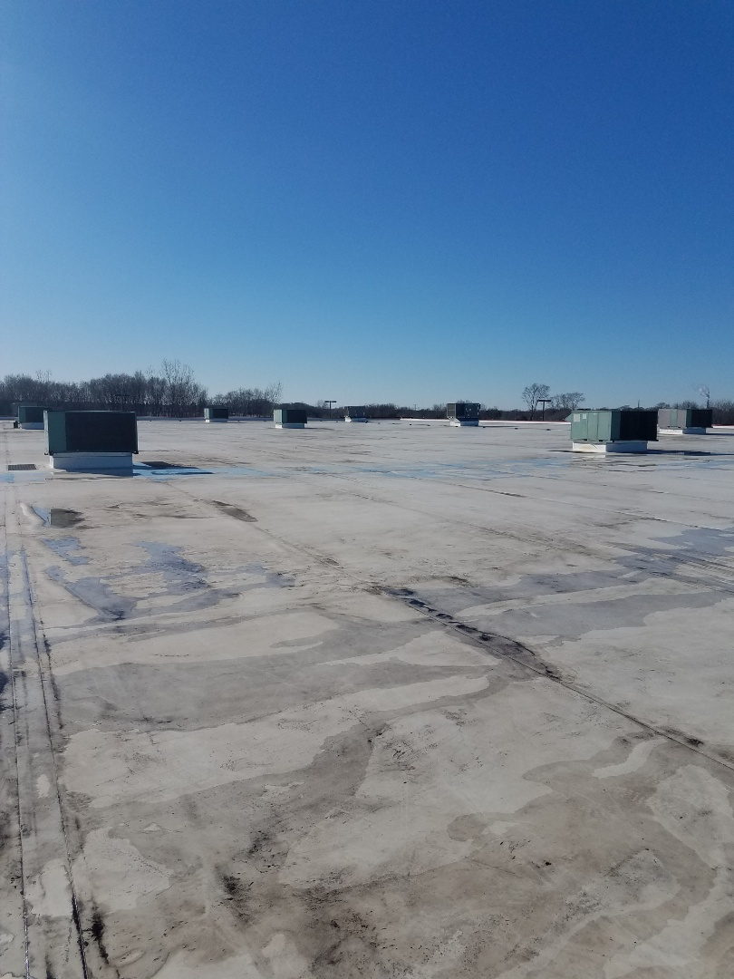 Monticello, MN - Commercial spring maintenance cleaning on rooftop units in monticello