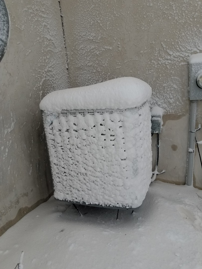 Independence, MN - Found heat pump not operating correctly. Covered in ice and snow causing it to overheat from lack of airflow, thawed out unit and returned operation in independance