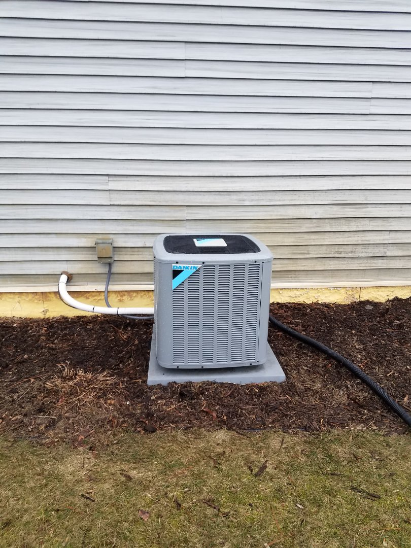 Dayton, MN - Cooling maintenance. Performed tune up and cleaning and installed drain pan treatment on a Daikin air conditioner
