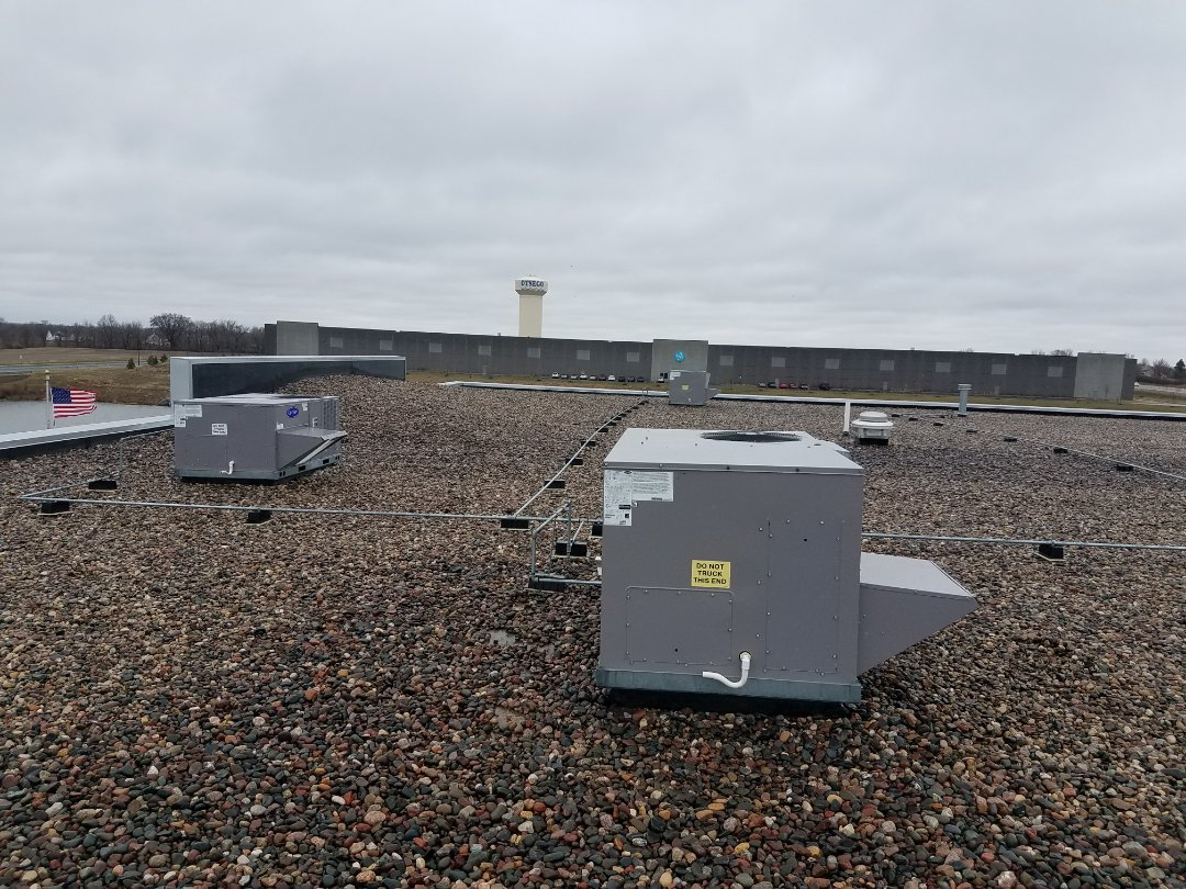 Otsego, MN - AC rooftop maintenance and cleaning in 3 carrier units in Otsego