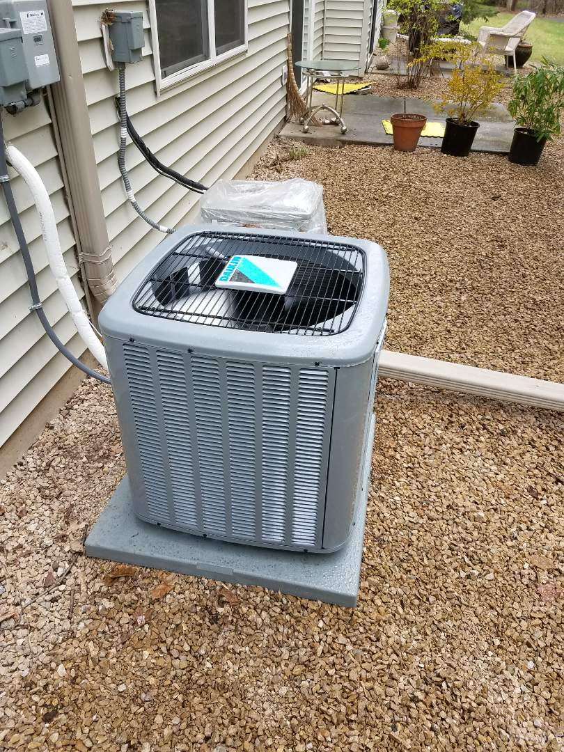 Osseo, MN - AC tune up and clean on Daikin unit in Rogers