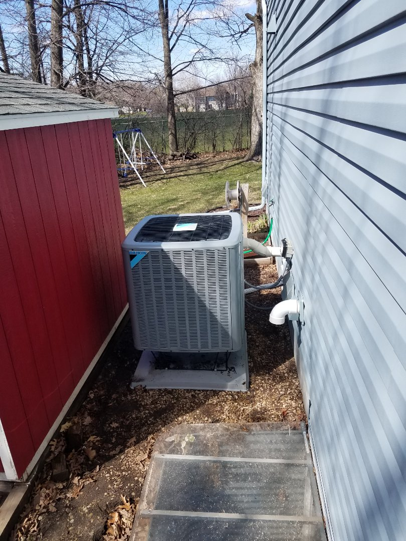 Albertville, MN - AC maintenance. Performed tune up and cleaning on a Daikin AC. Installed drain pan treatment.