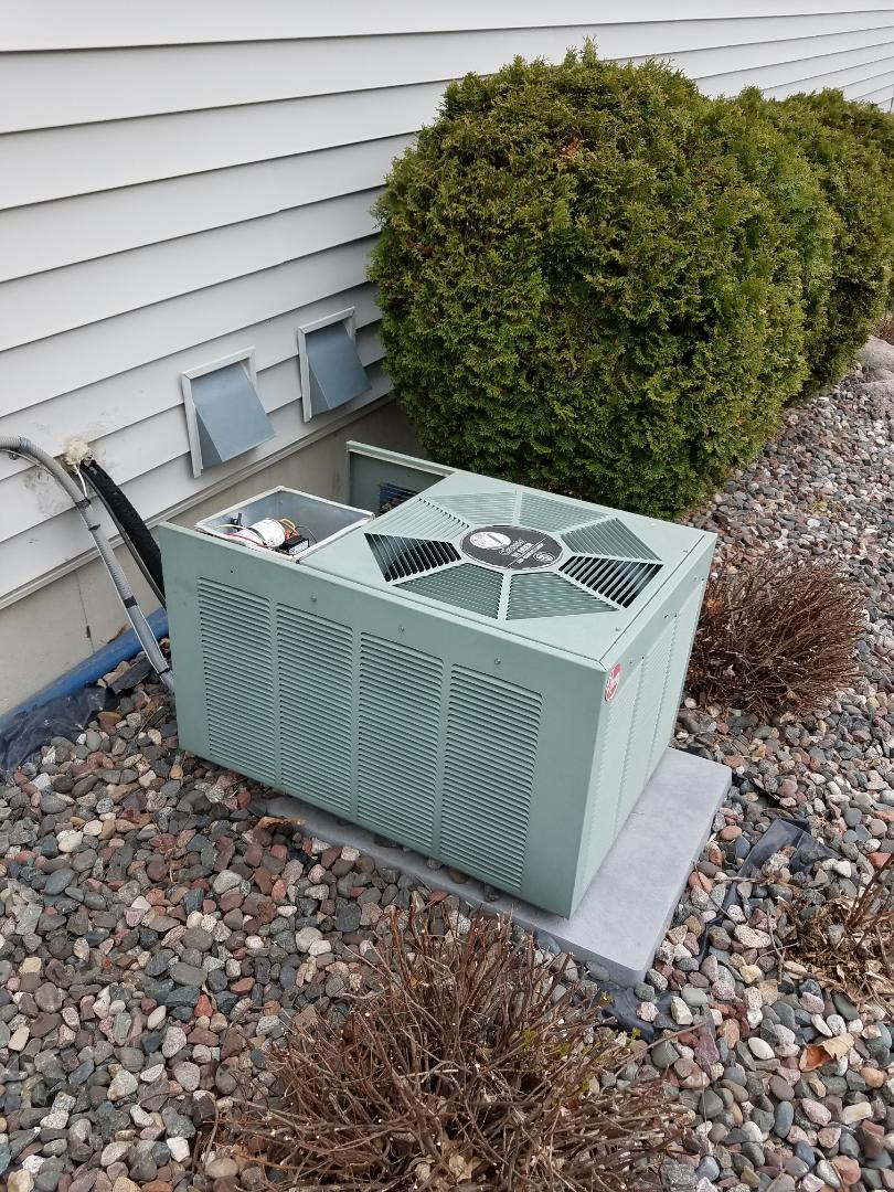 Maple Grove, MN - Air conditioning tune up and cleaning on ruud air conditioning
