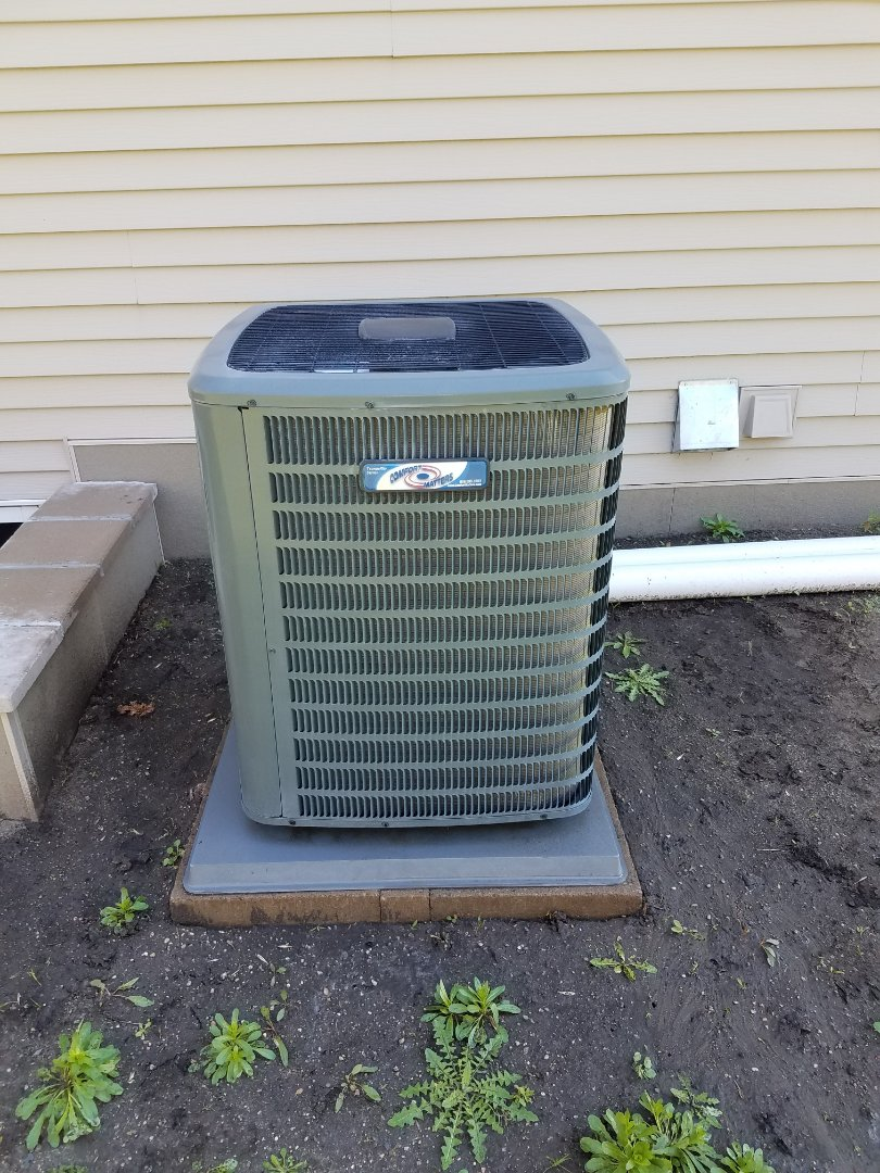 Hanover, MN - Cooling maintenance. Performed tune up and cleaning on a Comfort Matters AC. Installed drain pan treatment and cleaned blower wheel.
