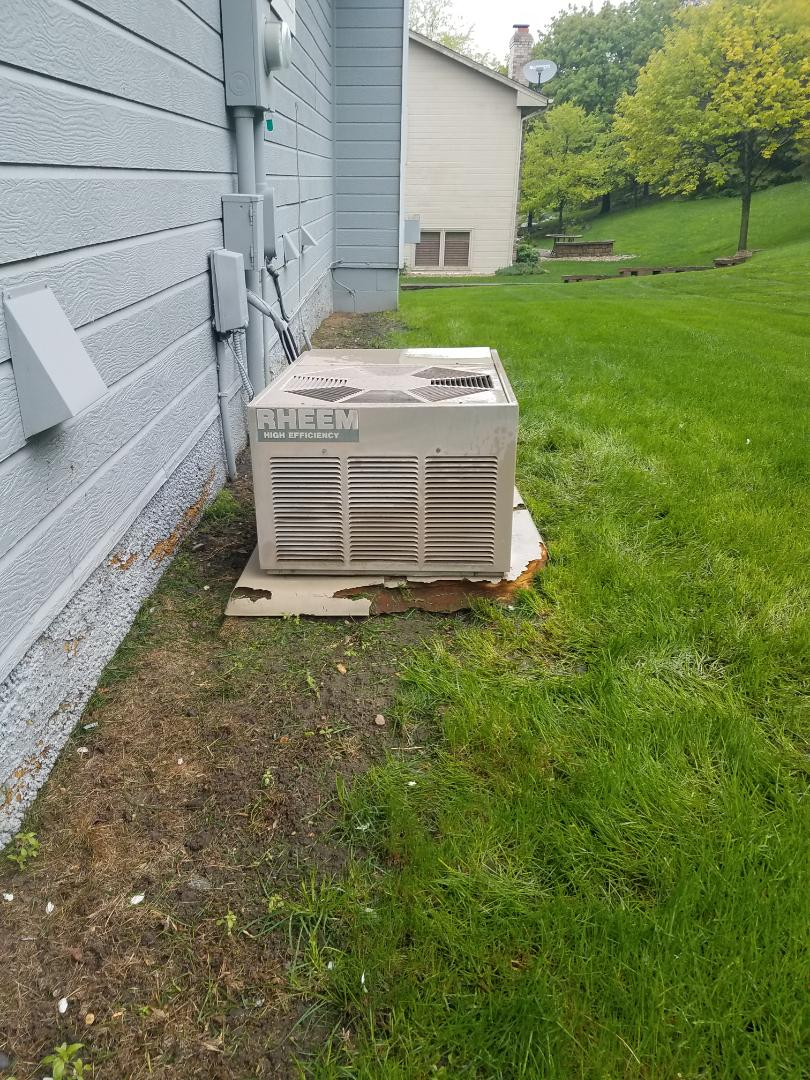 Osseo, MN - Cooling maintenance. Performed tune up and cleaning on a Rheem AC.