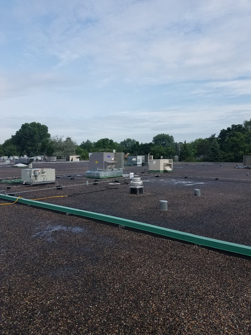 Rogers, MN - Commercial roof top ac cleaning on 17 Lennox units in Rogers