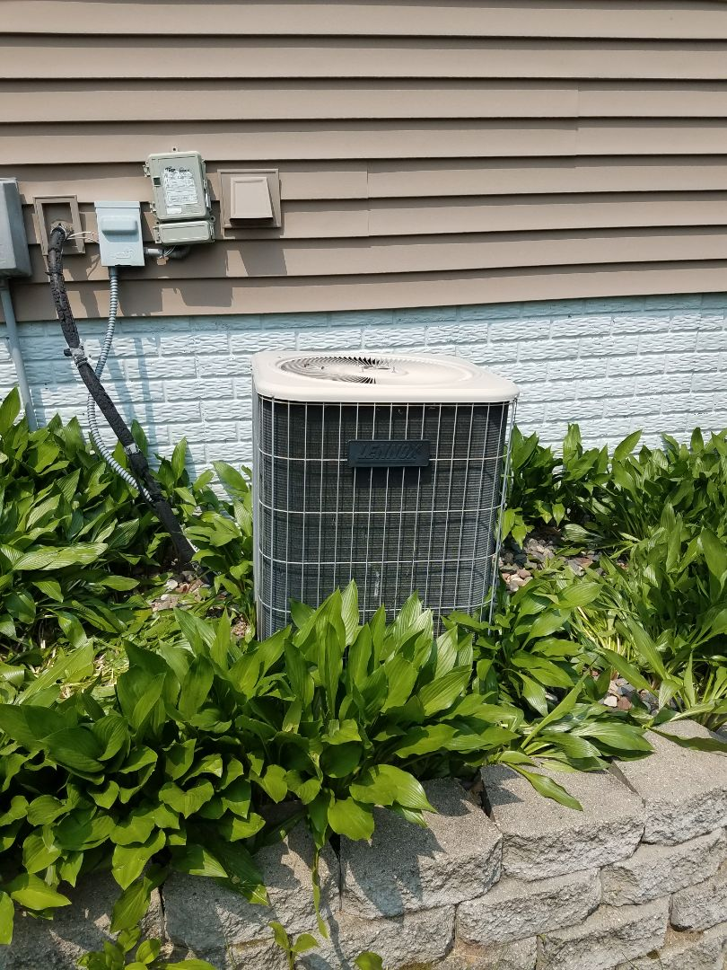 Hanover, MN - Cooling maintenance. Performed tune up and cleaning on a Lennox AC.