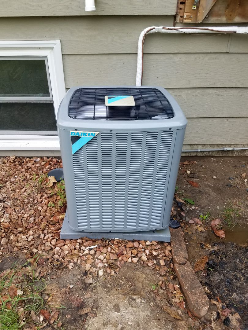 Buffalo, MN - Air conditioner maintenance. Performed tune up and cleaning on a Daikin air conditioner.