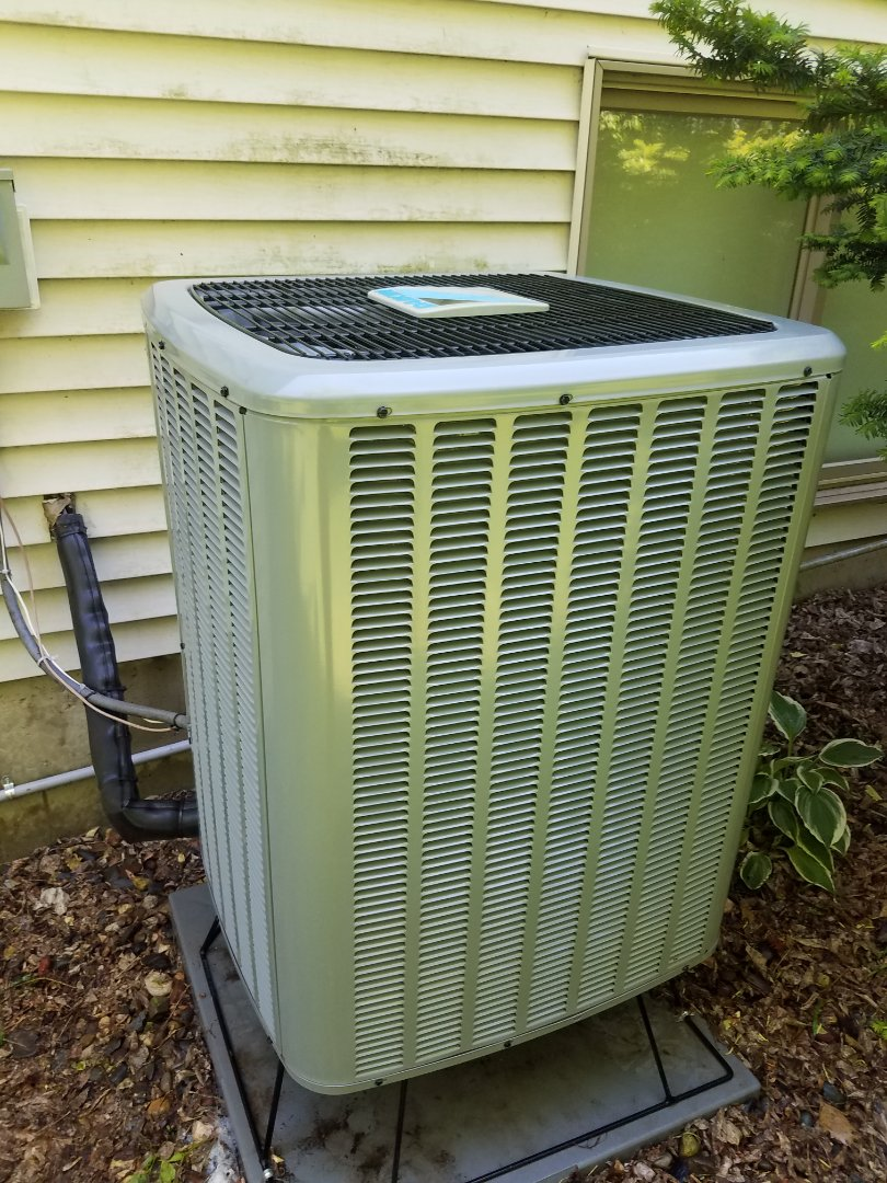 Buffalo, MN - Cooling maintenance. Performed cleaning and tune up on a Daikin heat pump. A Installed new drain pan treatment and ECM power protection.