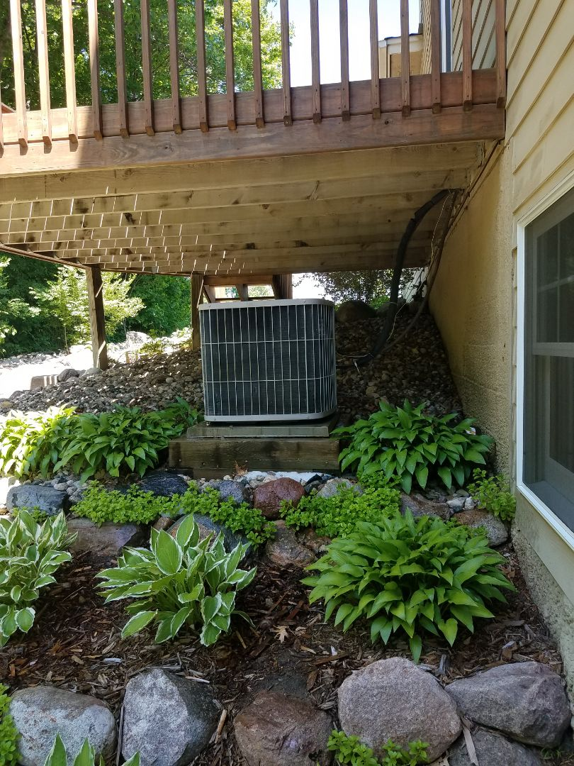 Wayzata, MN - AC tune up and clean on Carrier unit in Maple Plain