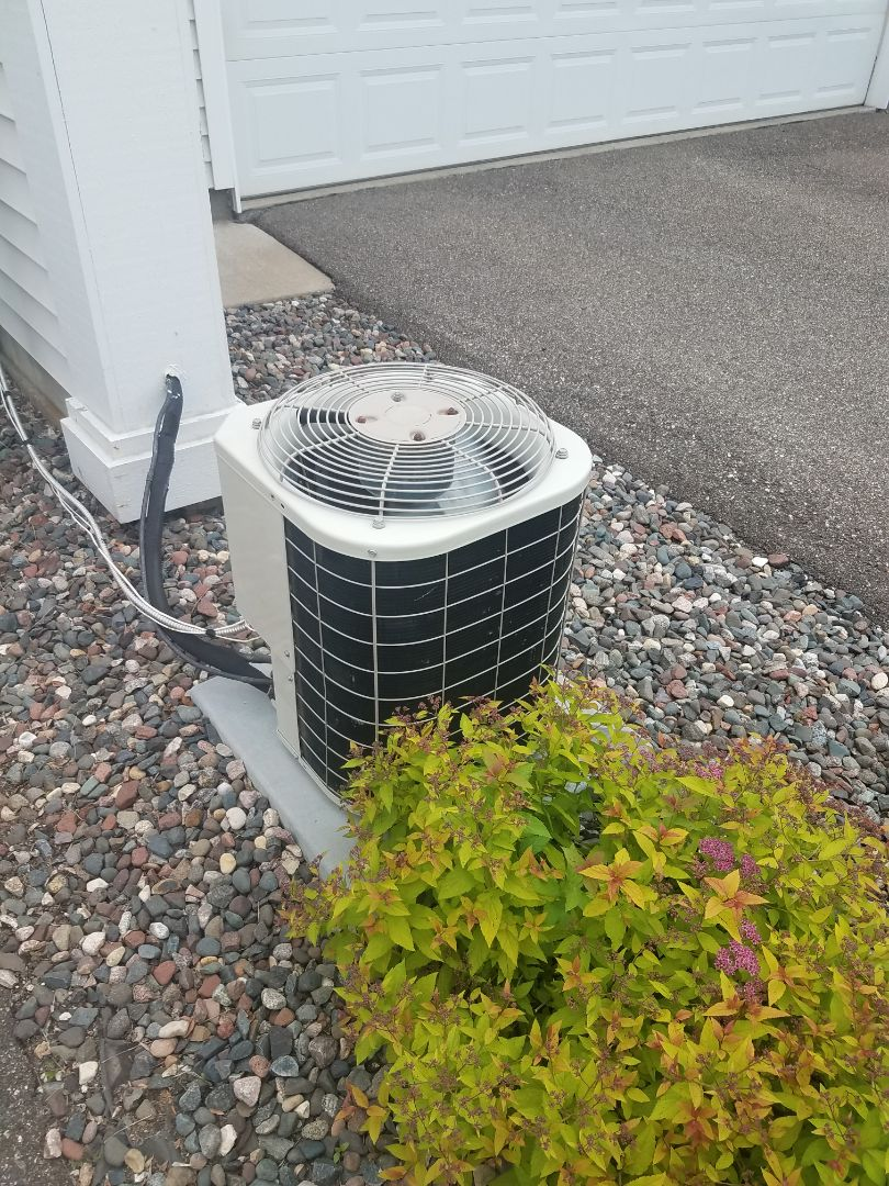 Osseo, MN - AC maintenance. Performed cleaning and tune up on a Carrier AC.