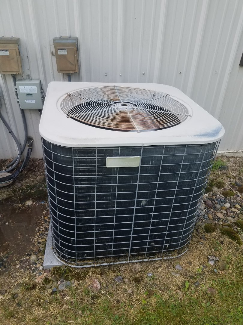Hanover, MN - AC maintenance. Performed cleaning and tune up on a Amana air conditioner. Installed a new Honeywell T4 Pro thermostat