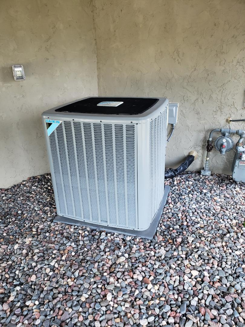 Dayton, MN - AC service. Adjusted indoor air flow and adjusted charge on a Daikin air conditioner.