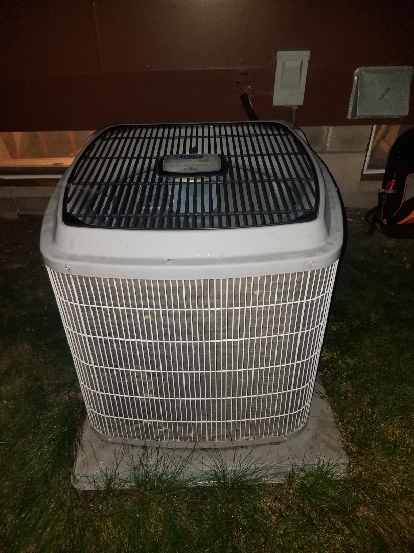 Anoka, MN - AC maintenance. Replaced failed universal motor booster on a Carrier air conditioner.
