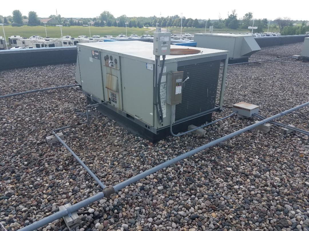 Minnetonka, MN - Commercial roof top repair, replaced condenser fan motor and blade on trane unit in Monticello