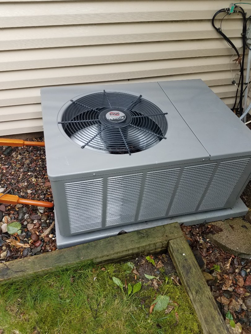 Buffalo, MN - Cooling maintenance. Performed tune up and cleaning on a Ruud air conditioner.