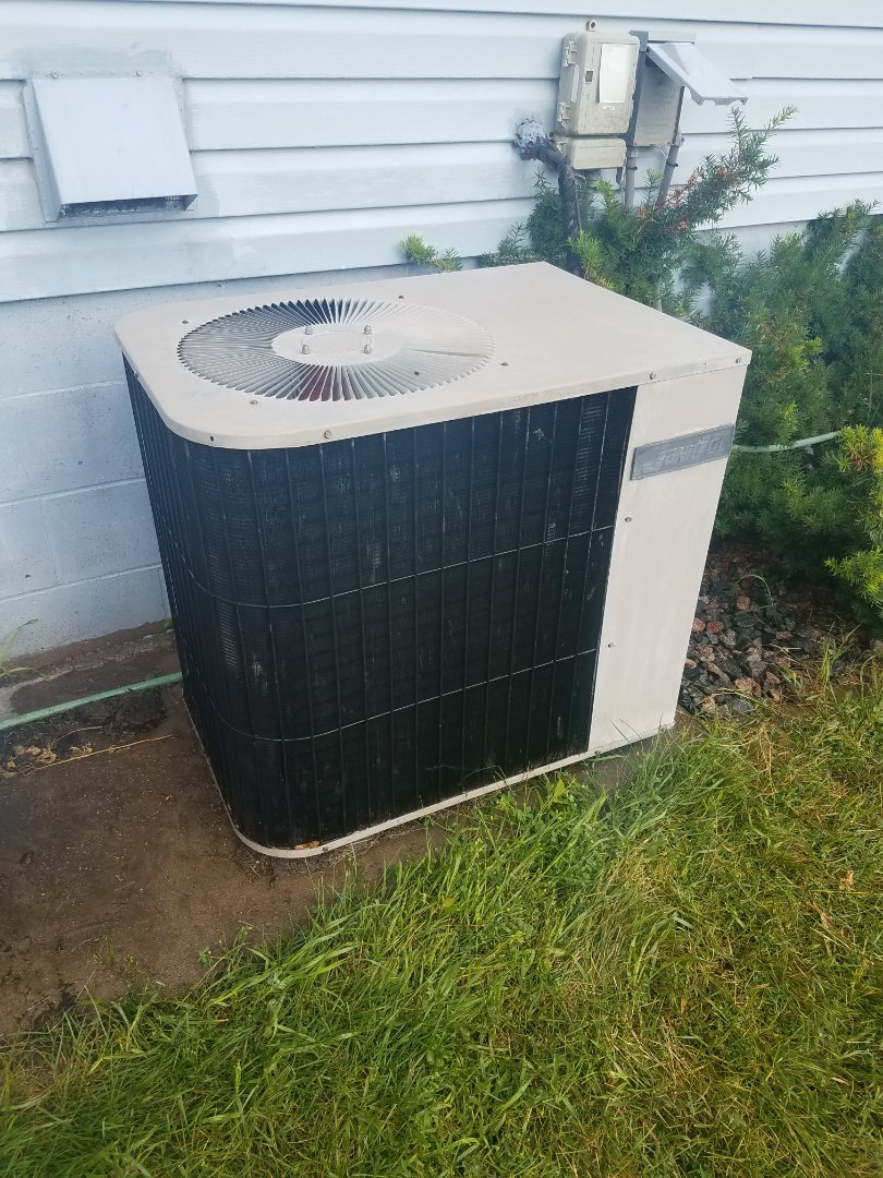 Hanover, MN - Cooling maintenance. Performed tune up and cleaning on a  j Janitrol air conditioner.