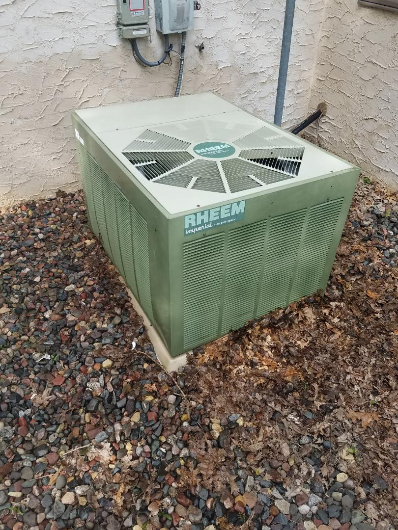 Hanover, MN - Cooling maintenance. Performed tune up and cleaning on a Rheem AC.