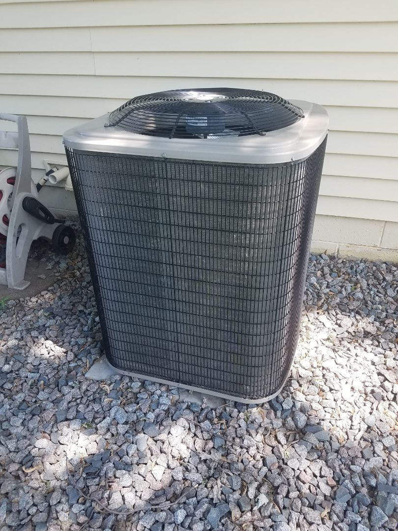 Albertville, MN - Cooling maintenance. Installed locking refrigerant caps on a Payne air conditioner.