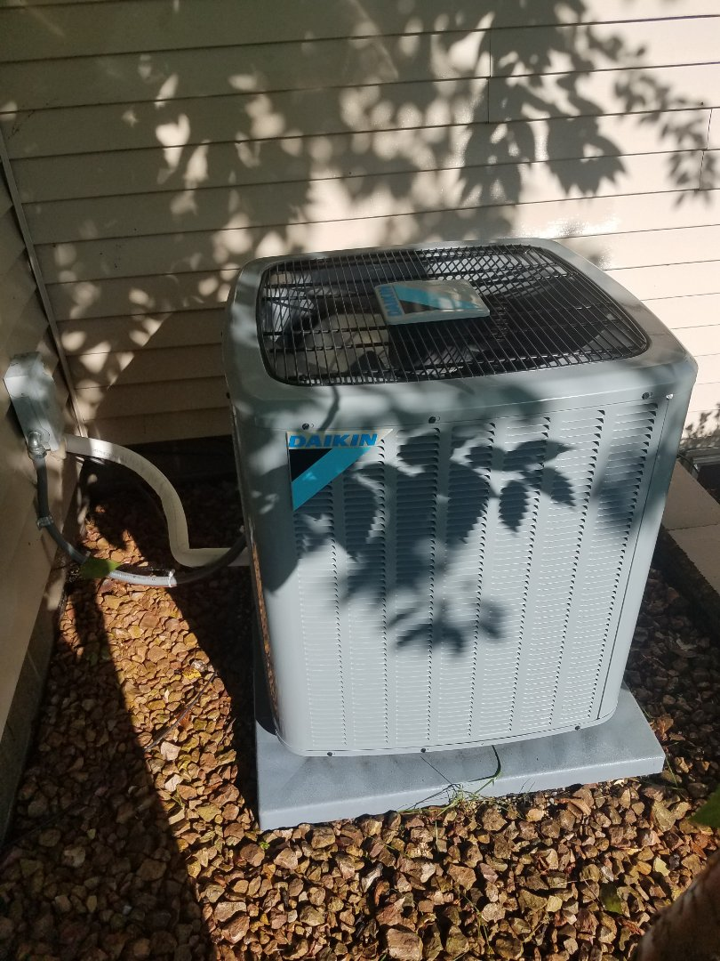 Osseo, MN - Cooling maintenance. Performed tune up and cleaning on a Daikin AC. Installed drain pan treatment