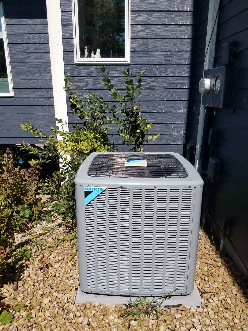 Loretto, MN - Cooling maintenance. Performed cleaning and tune up on a Daikin AC. Installed drain pan treatment and a new furnace filter