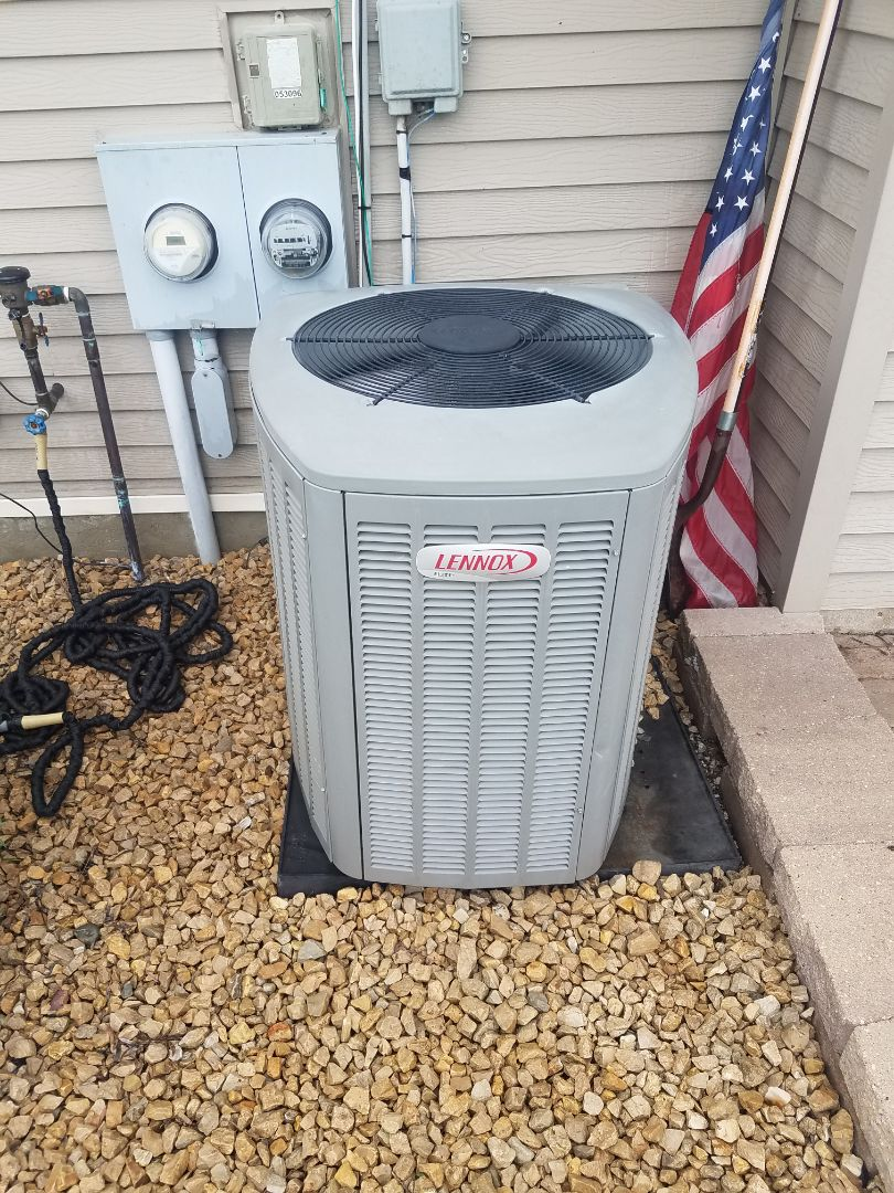 Buffalo, MN - AC maintenance. Performed tune up and cleaning on a Lennox AC. Installed synthetic AC oil treatment.