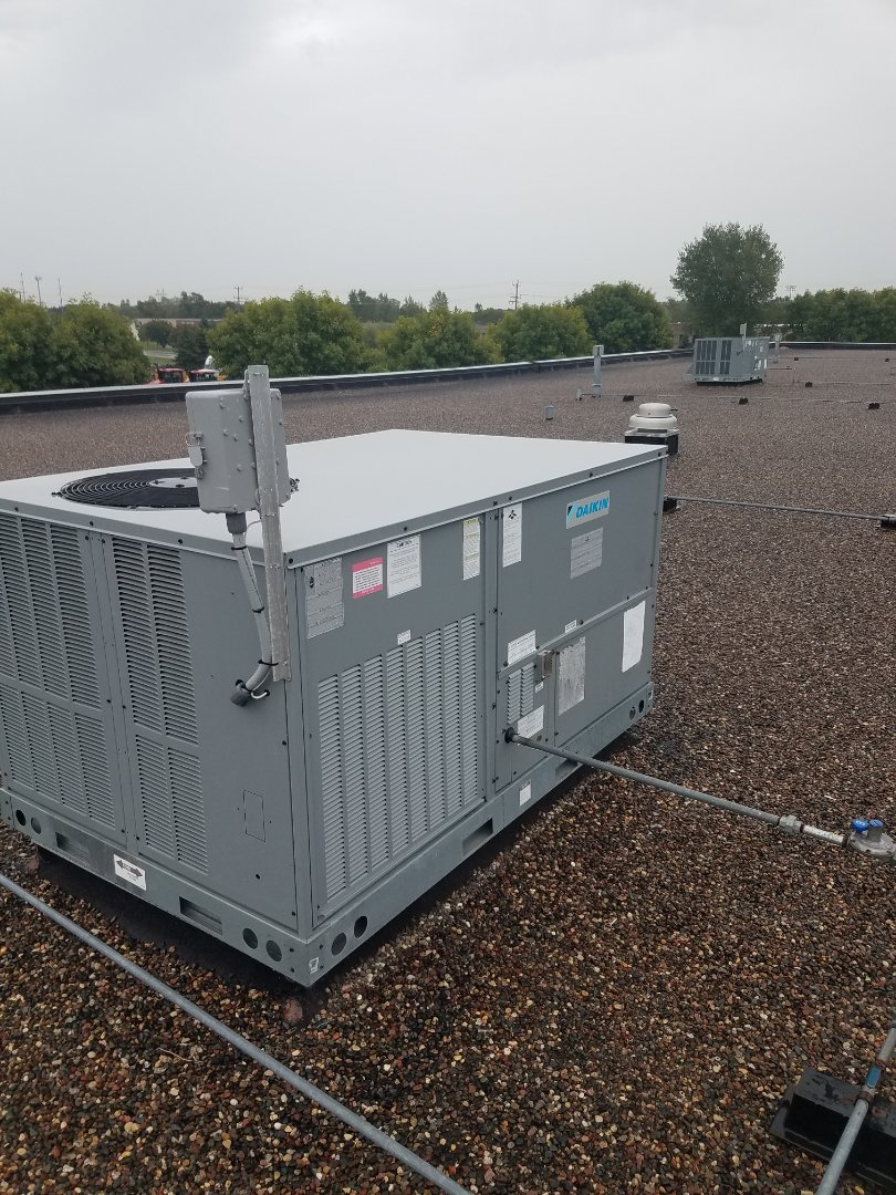 Rogers, MN - Rooftop unit maintenance. Performed diagnostics and belt change on a Daikin roof top unit.
