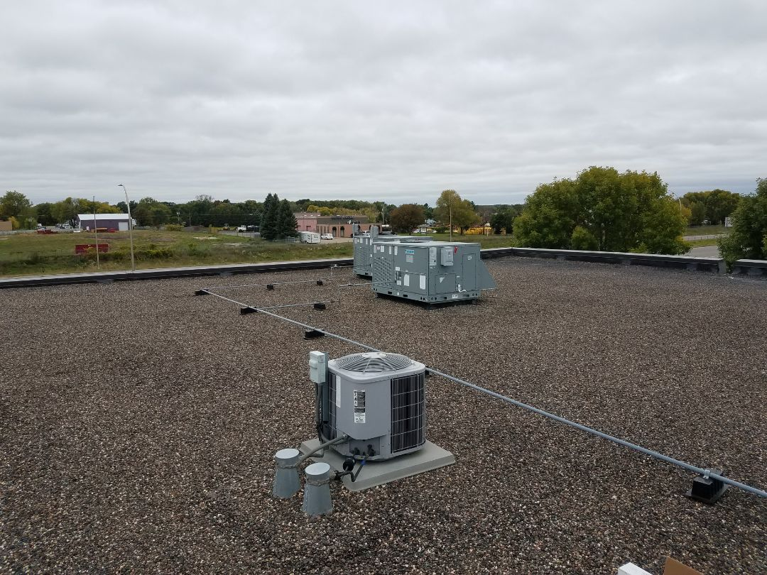 Rogers, MN - Commercial rooftop cleaning and tune up for heating on 7 RTU's in Otsego