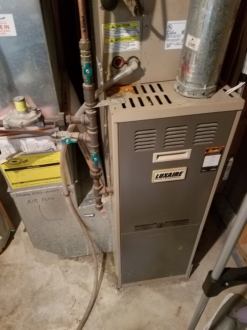 Saint Michael, MN - Furnace maintenance. Performed a tune up and cleaning on a Luxaire furnace. Installed a main flame safety sensor and cleaned furnace blower wheel.