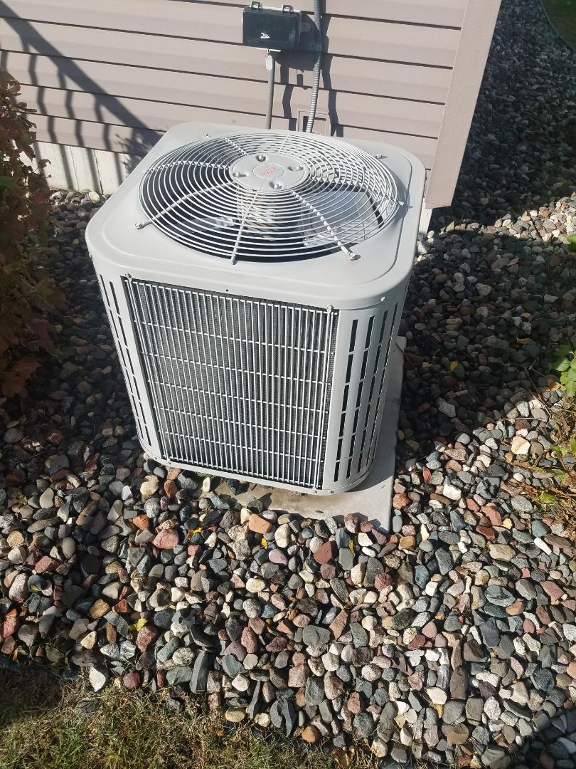 Brooklyn Park, MN - AC maintenance. Performed tune up and cleaning on a Bryant AC.