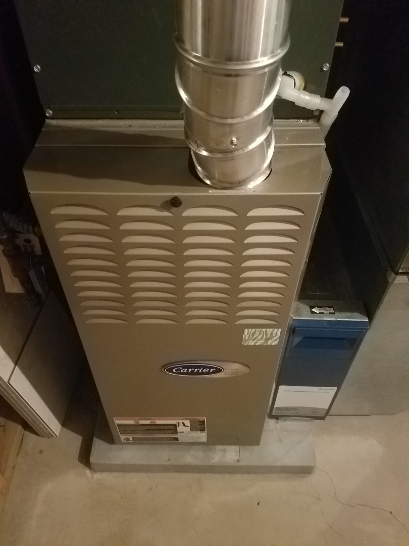 Osseo, MN - Furnace maintenance. Performed tune up and cleaning on a Carrier furnace.