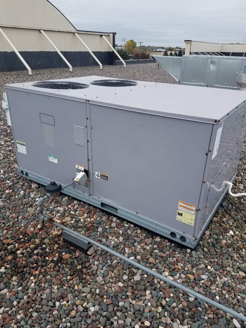 Rogers, MN - Roof top unit maintenance. Replaced failed blower motor belt and failed blower motor starter. Replaced unit filters